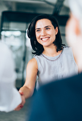 Smiling woman shaking hands