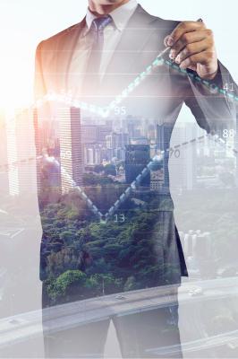 Man outlining city landscape