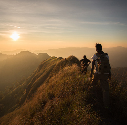 Group of people walking on mountain tops